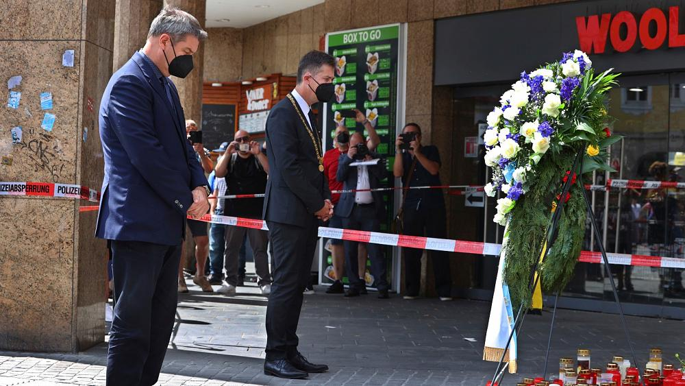 German city holds memorial for victims of knife attack that left three dead